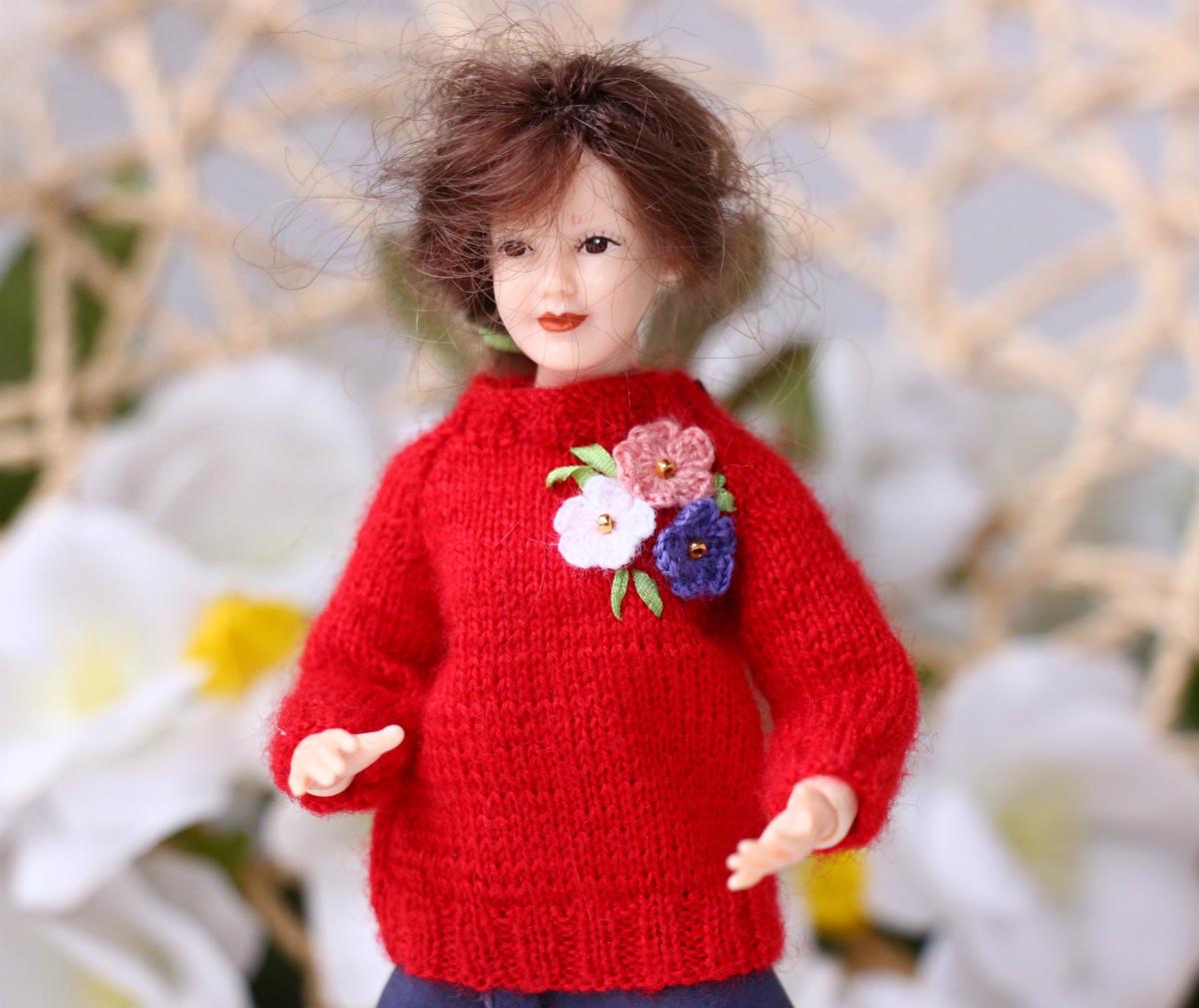 Heidi Ott lady doll red sweater.